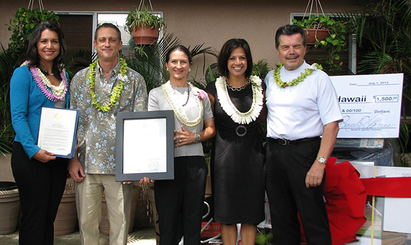 U.S. Congresswoman Tulsi Gabbard (far left) and State Representative Jessica Wooley (middle) present certificates to Habilitat and Toshiba executives, Jeffrey Nash (second from left) and Greg Valen (far right).