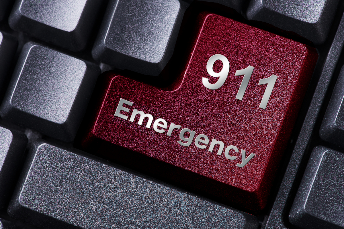 Red key on a keyboard stating 911 Emergency